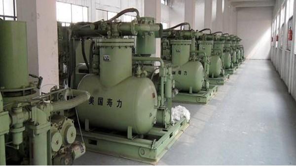 螺杆式空压机的普及是由什么推动的?